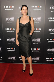 Neve Campbell paired her ladylike knee length dress with black patent platform peep-toes.