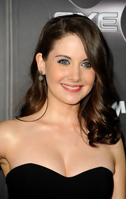 Alison Brie enhanced her look with a pair of dangling spheres when she attended the 'Scream 4' premiere.