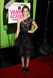 Zoey Deutch worked an ultra-girly vibe at the 'Vampire Academy' premiere in a Monique Lhuillier one-shoulder LBD with a beaded bodice and a tiered skirt.