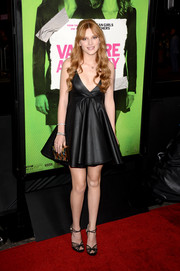 Bella Thorne complemented her dress with an embellished gold box clutch by Emm Kuo.