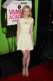 Dove Cameron donned a simple yet sweet bow-adorned white mini dress for the 'Vampire Academy' premiere.