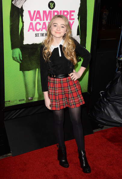 A pair of black peep-toe booties added a touch of edginess to Sabrina Carpenter's look.