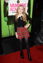 Sabrina Carpenter attended the 'Vampire Academy' premiere looking preppy in a long-sleeve black top with a white collar.