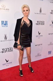 Maggie Grace kept the sex appeal going with a black leather mini skirt.