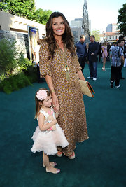 Ali looked hippie-chic at the 'Zookeeper' premiere wearing a leopard kaftan with a matte gold Global Tassel necklace.