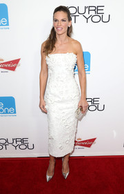 A Calvin Klein box clutch rounded out Hilary Swank's silver-themed accessories.