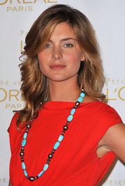 Vittoria's statement turquoise necklace really popped against her bright red dress.