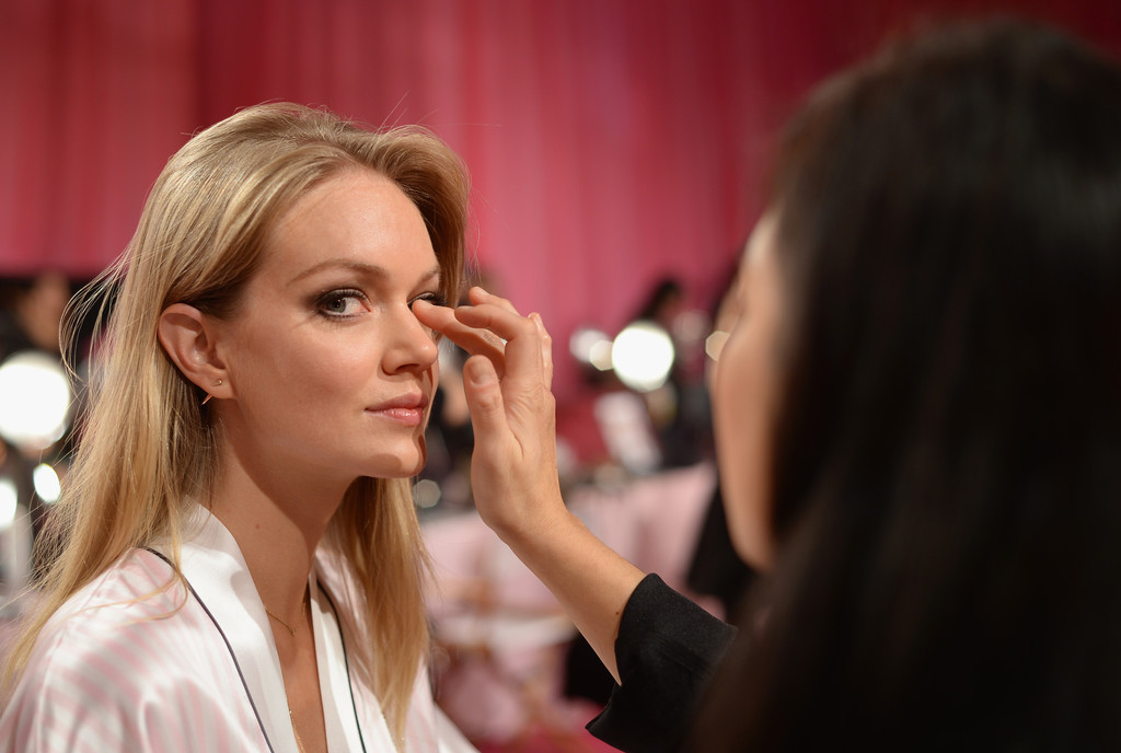 Model Lindsay Ellingson prepares at the 2013 Victoria's Secret Fashion Show hair and make-up room at Lexington Avenue Armory on November 13, 2013 in New York City.