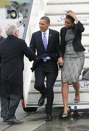 Michelle Obama complemented her outfit with a cute pair of bow-adorned black-and-white pumps.