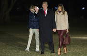 Melania Trump cozied up in a taupe cashmere pea coat by Bottega Veneta for her return to the White House from Mar-a-Lago.