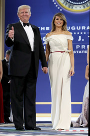 Melania Trump looked downright regal at the inaugural Armed Forces Ball in a white Hervé Pierre off-the-shoulder gown with red trim and origami detailing.