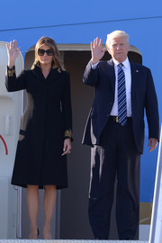 Melania Trump kept it classy in a black wool coat with an embroidered collar and cuffs for her visit to the Quirinale Presidential Palace.
