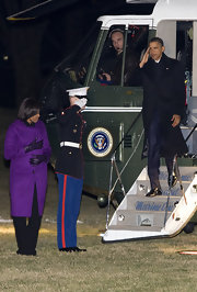 Michelle Obama's purple wool coat was a stylish way to keep warm.