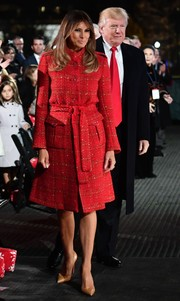 Melania Trump balanced out her brightly hued coat with neutral pumps by Christian Louboutin.