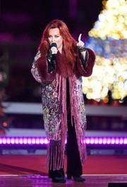 Wynonna Judd looked lavish in a fringed, floral-embroidered coat with fur lapels and cuffs during her performance at the National Christmas Tree Lighting Ceremony.
