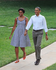 For a bright pop of color, Michelle Obama paired orange ballet flats with her black-and-white dress.