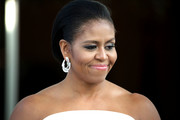Michelle Obama attended the state dinner for Singapore's Prime Minister wearing her hair in a slicked-back faux bob.
