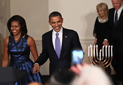 Michelle Obama pulled her stylish look together with a multi-strand black pearl necklace during a Hanukkah reception at the White House.