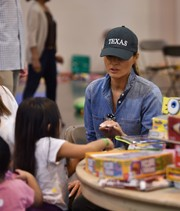 Melania Trump sported a teal 'Texas' baseball cap while participating in Hurricane Harvey relief efforts.