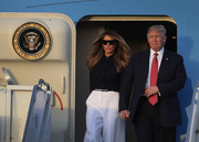 Melania Trump went modern with these shield sunglasses during her flight to Florida.