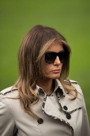 Melania Trump accessorized with a pair of bold square sunnies.