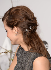 Emma Watson added more glitter via a pair of diamond hoop earrings.