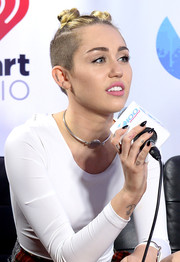 Miley Cyrus teamed a sterling choker with a white bodysuit for Y100's Jingle Ball 2013.