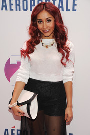 Nicole Polizzi styled her outfit with a pearl bracelet and a matching necklace when she attended the Z100 Jingle Ball.