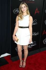 Sasha Pieterse went for a modern vibe in a sleeveless white ICB mini dress with peplum detailing during the 'Pretty Little Liars' 100th episode celebration.