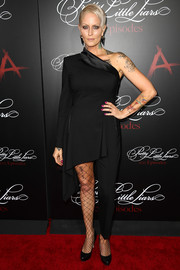 Mandi Line showed off her unique fashion sense with this one-sleeve, one-leg jumpsuit at the 'Pretty Little Liars' 100th episode celebration.