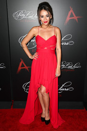 Janel Parrish chose a bright red fishtail dress with cutouts on the bodice for the 'Pretty Little Liars' 100th episode celebration.