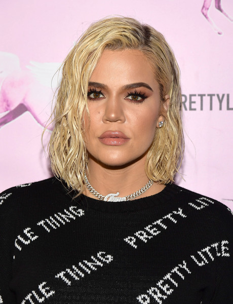 Khloe Kardashian wore her hair in wet-look waves at the PrettyLittleThing LA office opening party.