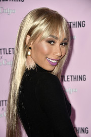 Eva Gutowski attended the PrettyLittleThing x Olivia Culpo launch wearing a cute pair of feathered earrings.