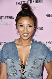 Jeannie Mai sported a casual top knot at the PrettyLittleThing x Olivia Culpo launch.