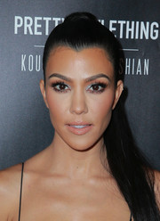 Kourtney Kardashian styled her hair into a tight ponytail for the launch of her PrettyLittleThing collection.