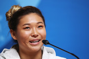 Chloe Kim wore her hair in a bun at the 2018 Winter Olympic Games press conference.