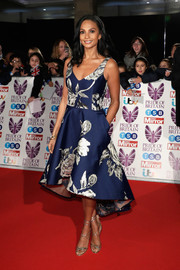 Alesha Dixon polished off her red carpet look with gold multi-strap sandals.