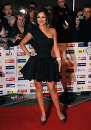 The actress completed her adorable black cocktail dress with a pair of metallic platform pumps. The glamorous heels complemented the young and modern style of her dress.