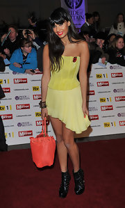 Jameela Jamil was the perfect blend of sexy and sweet in this lemon dress featuring a fitted bustier and flowing asymmetrical skirt.