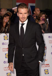 David Beckham attended the Pride of Britain awards wearing a classic black tux.