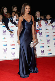 Michelle Keegan paired her slinky gown with a classic silver box clutch, also by Amanda Wakeley.