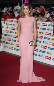 Cheryl Cole was pretty in pink on the red carpet at the Pride of Britain awards. The British starlet donned a evening dress with a paneled waist and exposed back zipper detail.