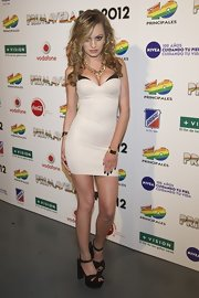 Alexandra Stan has the petite figure to carry off this tight white number she wore at the Primavera Pop 2012 Festival in Spain.
