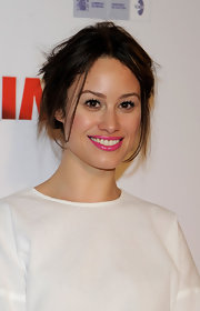 Aida Foch added a pop of color to her look with hot pink lipstick. She opted to keep the rest of her look natural.