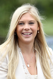 Chelsy Davy wore a delicate oval pendant necklace on a sterling chain.