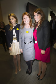 Sarah Ferguson posed with her daughters at the BGC Charity day wearing a classic gray dress and blazer.