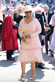 Oprah Winfrey looked prim and proper in a lace-trimmed blush cocktail dress by Stella McCartney at the wedding of Prince Harry and Meghan Markle.