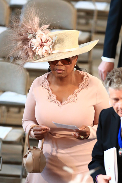 Oprah Winfrey put on a flower-and-feather-adorned hat by Philip Treacy for the wedding of Prince Harry and Meghan Markle.