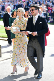 Carey Mulligan looked lovely in a floral-embroidered dress by Erdem at the wedding of Prince Harry and Meghan Markle.