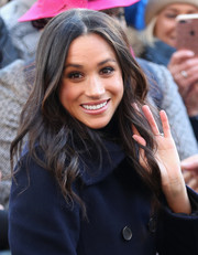 Meghan Markle visited the Terrance Higgins Trust World AIDS Day charity fair wearing her hair in a cascade of waves.